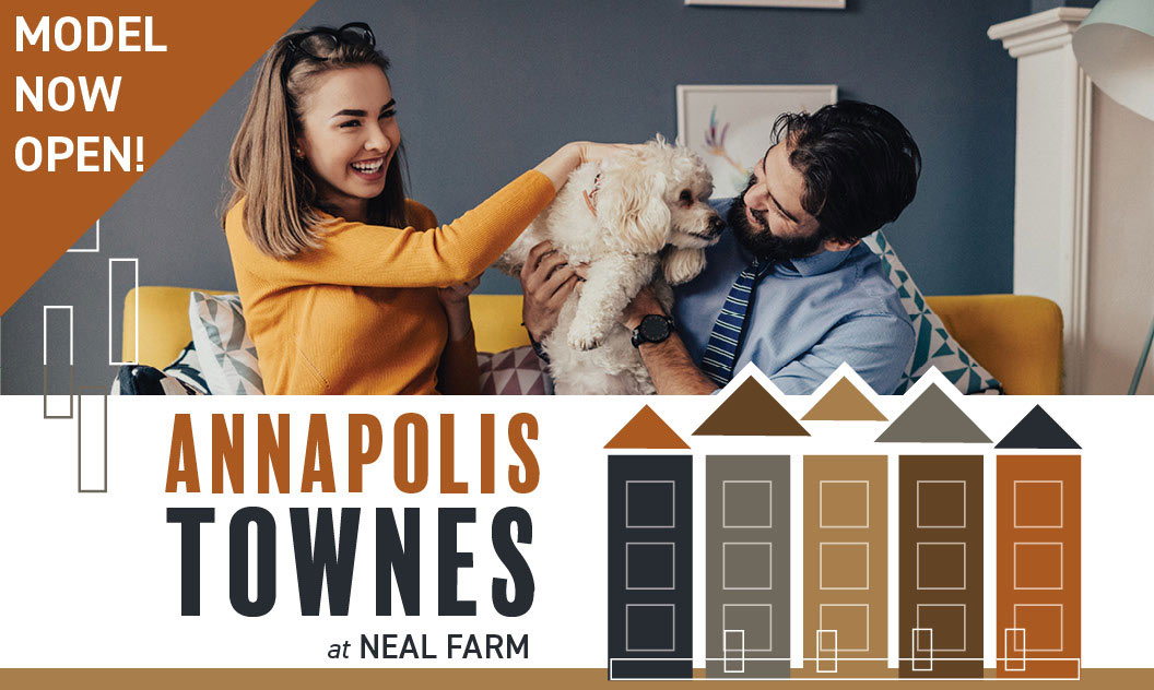 Young couple playing with cute dog with the text Annapolis Townes at Neal Farm - Model Now Open!